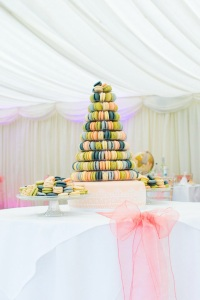 Multi coloured macaron tower and iced wedding cake