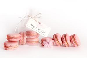 Raspberry cream macarons in organza favour bag