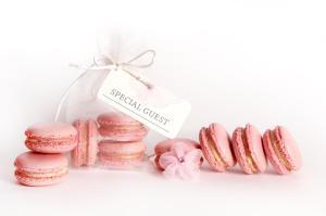 Raspberry cream macarons in organza favour bag