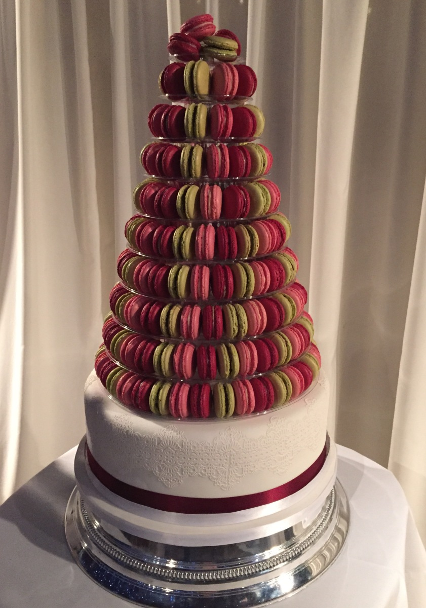 raspberry, pink and pistachio macarons on wedding cake