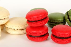 red, green and white macarons filled with chocolate ganache