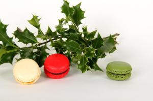 red, white and green macarons with holly