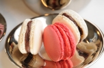 pink and white macarons on a silver plate