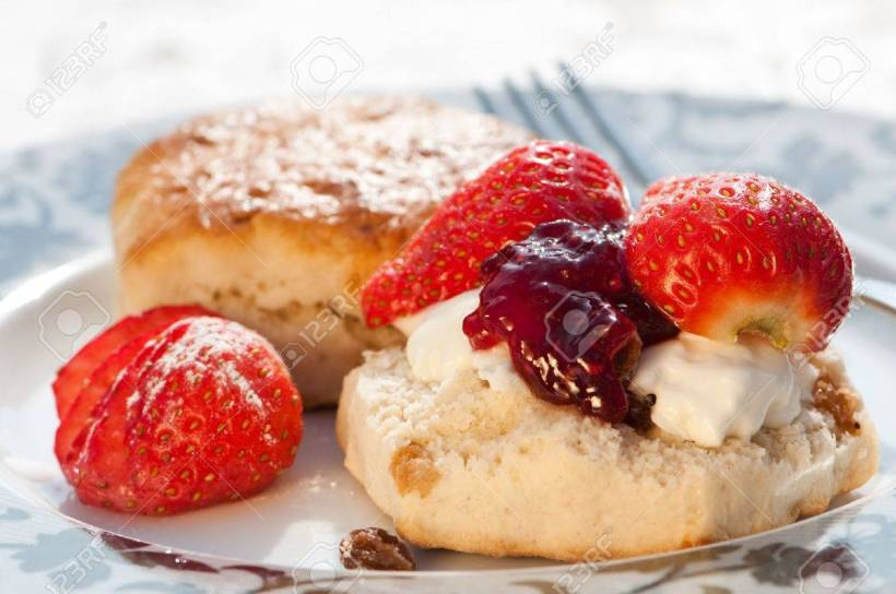 5107428-plate-of-strawberry-scones-with-clotted-cream-and-jam